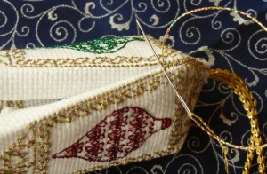 Sewing ornament seams together